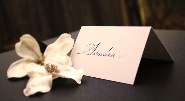 Black place cards with silver calligraphy for weddings Folded wedding place
