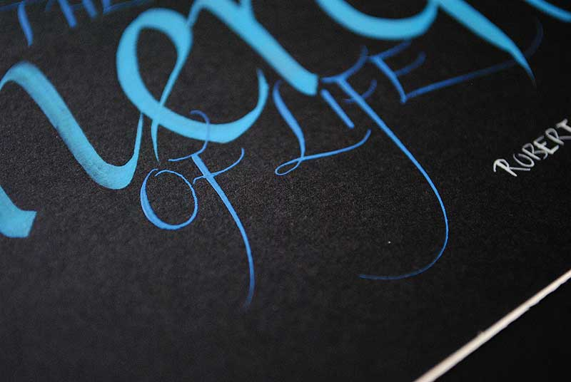 calligraphy-art-blue-silver-close-up