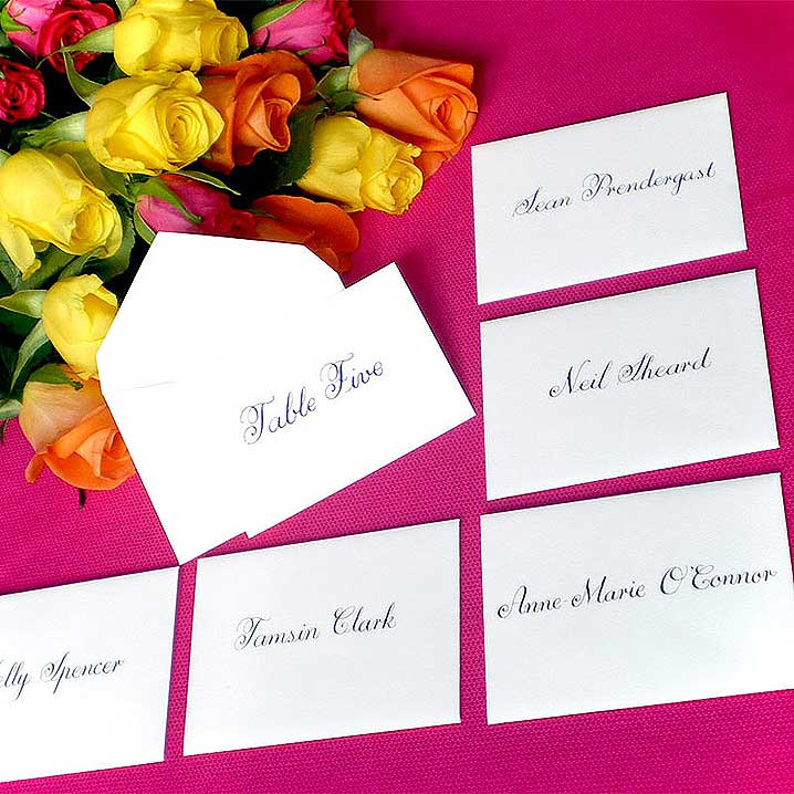 Escort cards can stand alongside a wedding seating plan or replace one