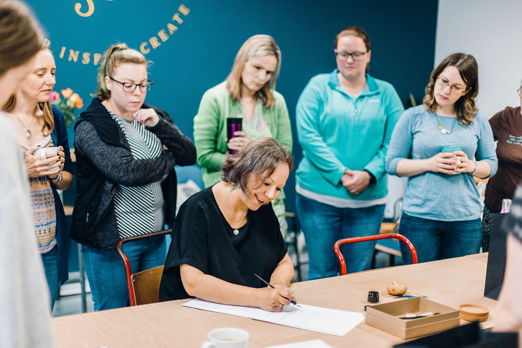 Calligraphy workshop with Claire demonstrating, image by Jessica Reeve Photography