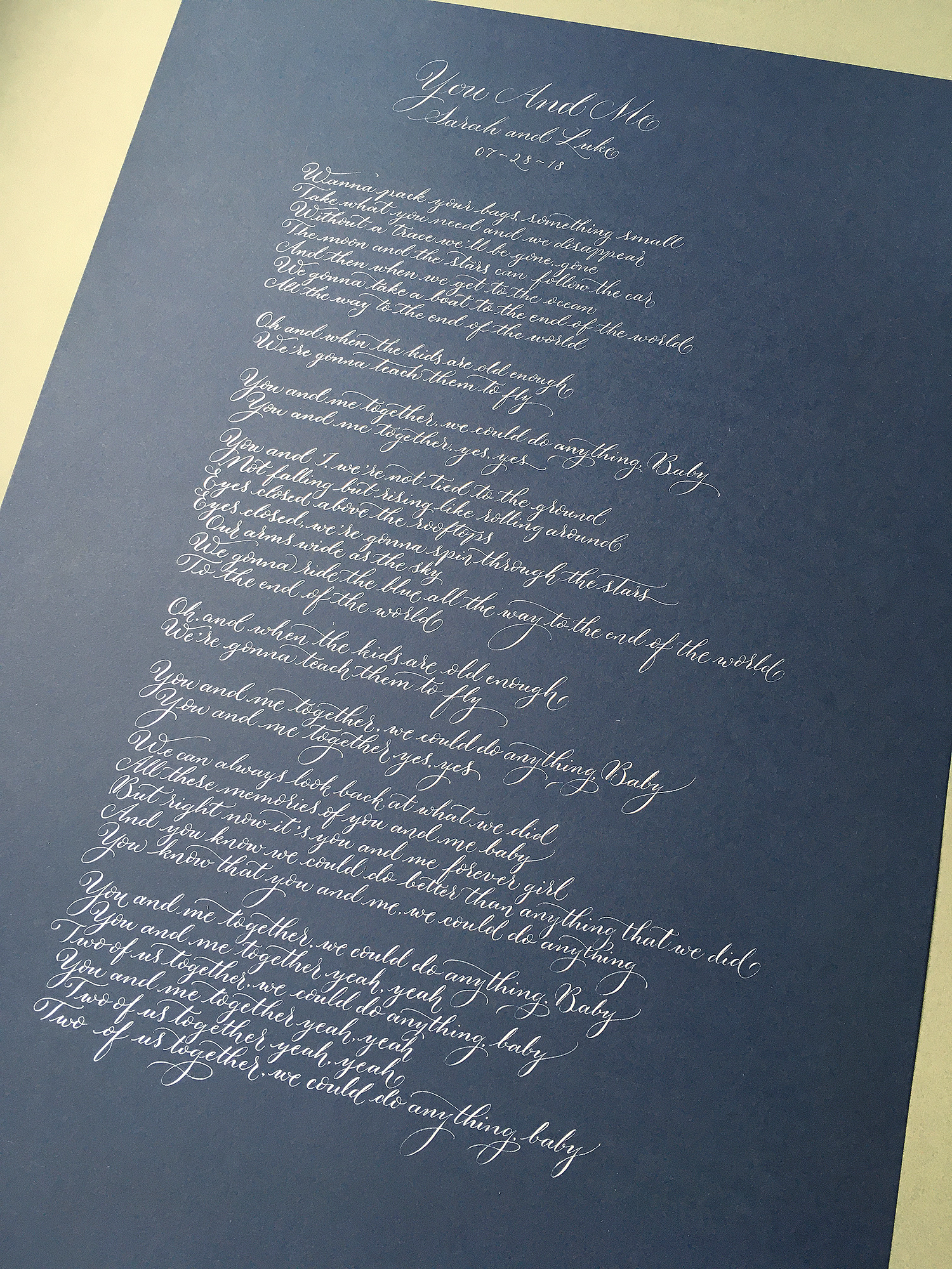 calligraphy commission white ink on navy blue song lyrics