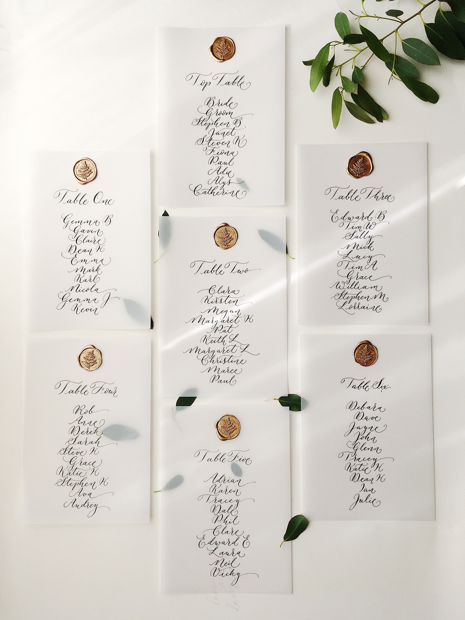 wedding table plan cards in calligraphy